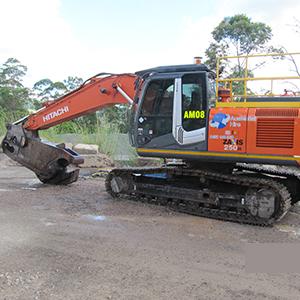 Hitachi excavator with scrap shears attachment