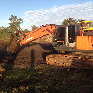 Hitachi excavator with grab and shears